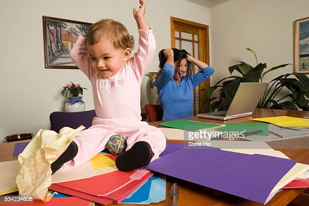Baby Making Mischief on Mother's Desk