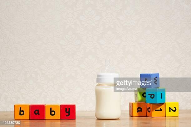 Baby milk and alphabet blocks
