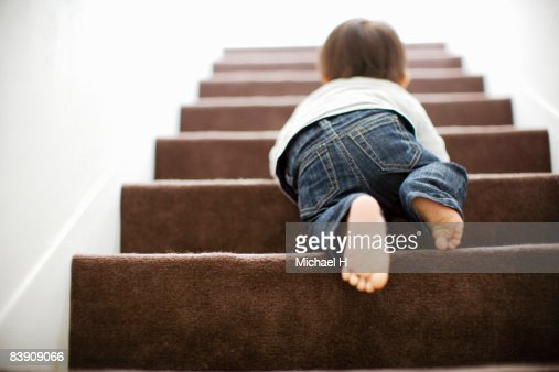 Baby mounts the stairs by crawling