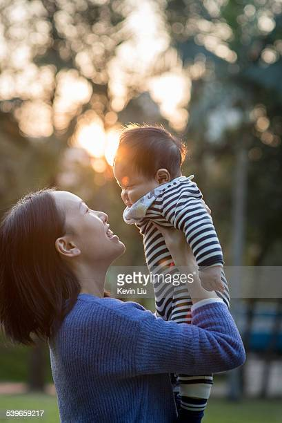 Baby & mum in front of setting sun