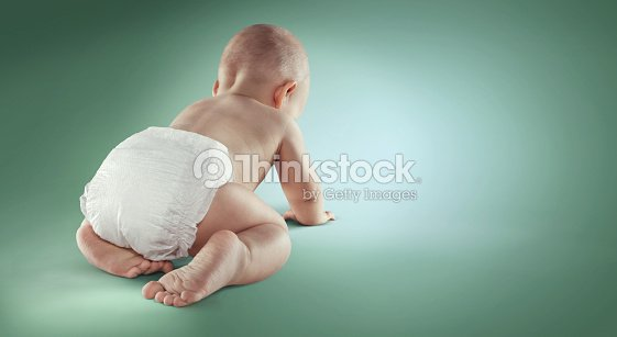 baby newborn in the diapers isolated back view ストックフォト