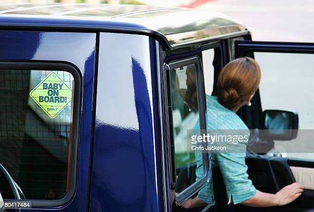 A 'baby on board' sticker hangs in the rear window of the royal Mercedes AMG as HRH Princess Haya Bint Al Hussein gets in her car to leave the 3rd...