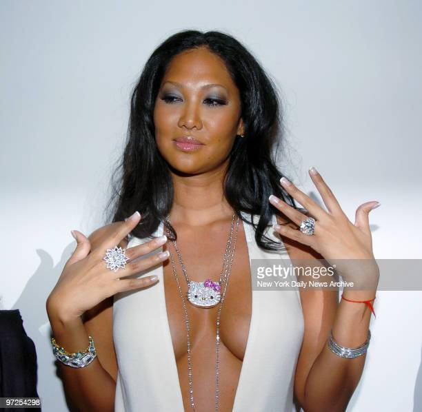 Baby Phat designer Kimora Lee Simmons displays some of the new jewelry she has created for her line including a $50000 diamond Hello Kitty pendant...