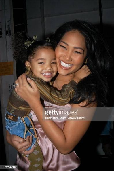 Baby Phat Designer Kimora Lee Simmons Holds Daughter Ming