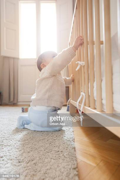 Baby playing in his room