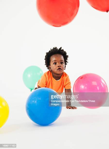 Baby playing with balloons