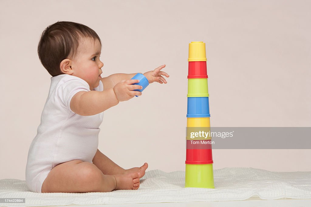 A baby playing with building toys : Stock Photo