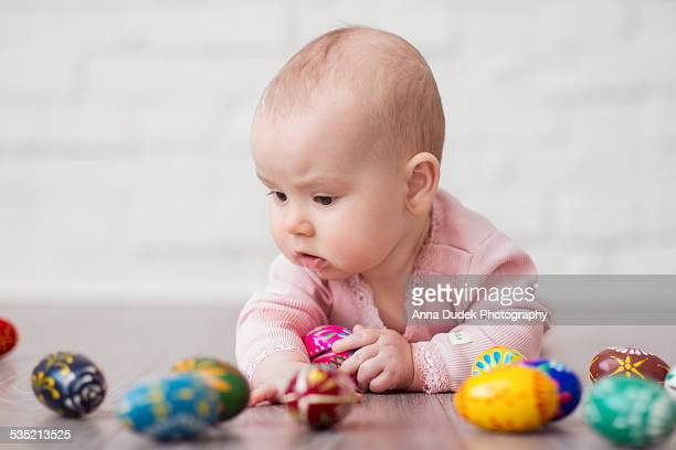 Baby playing with easter eggs
