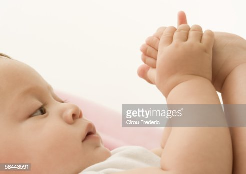 Baby playing with foot