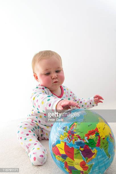 baby playing with globe ball
