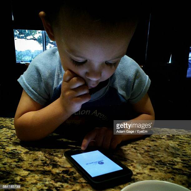 Baby Playing With Mobile Phone At Home