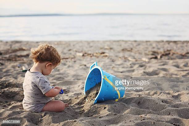 Baby playing with sand