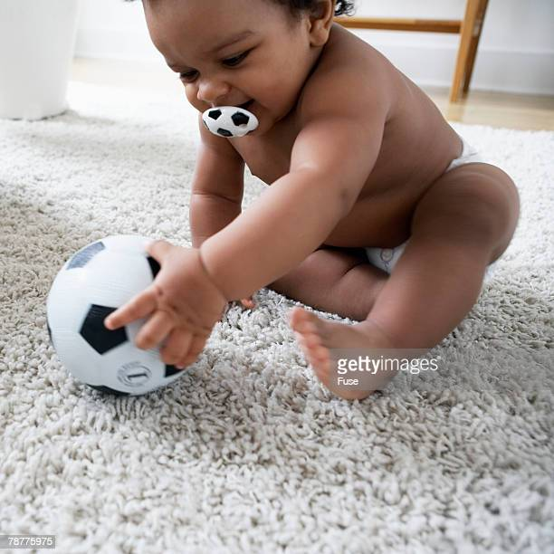 Baby Playing With Toy Soccer Ball