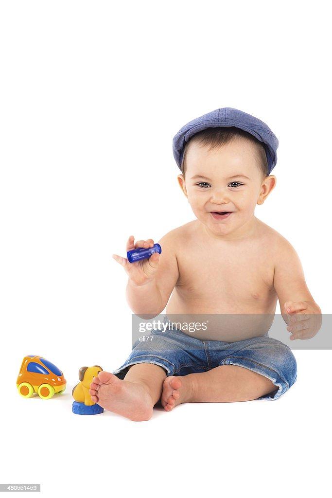 Bebê brincando com brinquedos isolado em fundo branco : Foto de stock
