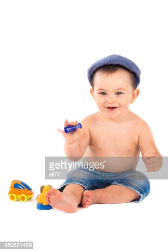 Baby playing with  toys isolated on white background : Stock Photo