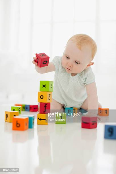 Baby playing with wood blocks