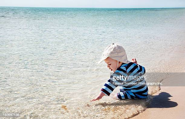 Baby plays in ocean