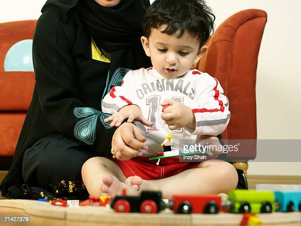 Baby plays with his Mother