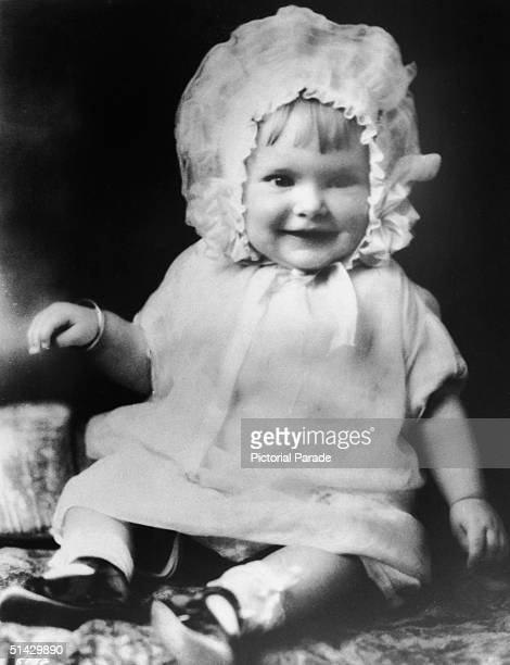 Baby portrait of American actress Janet Leigh as she sits and wears a baby bonnet 1927