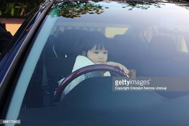 Baby pretending to drive
