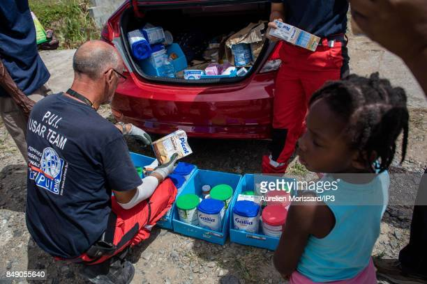 Baby products are distributed in the Orleans neighborhood ten days after the passage of hurricane Irma on September 15 2017 in Saint Martin French...