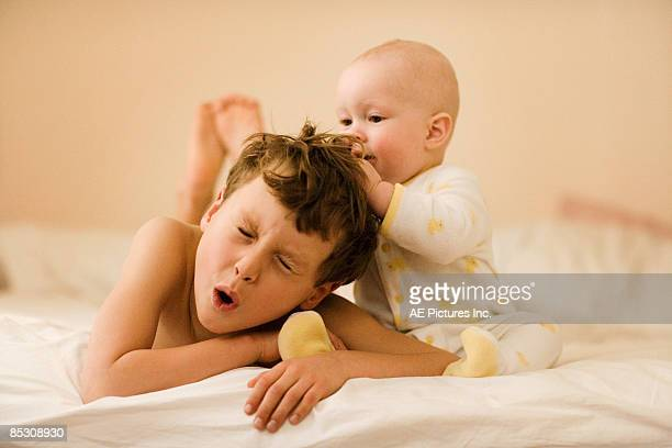 Baby pulls big brother's hair