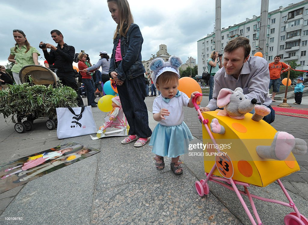 A baby pushes a pram during the First Festival of Prams in Kiev on May 21, 2010.