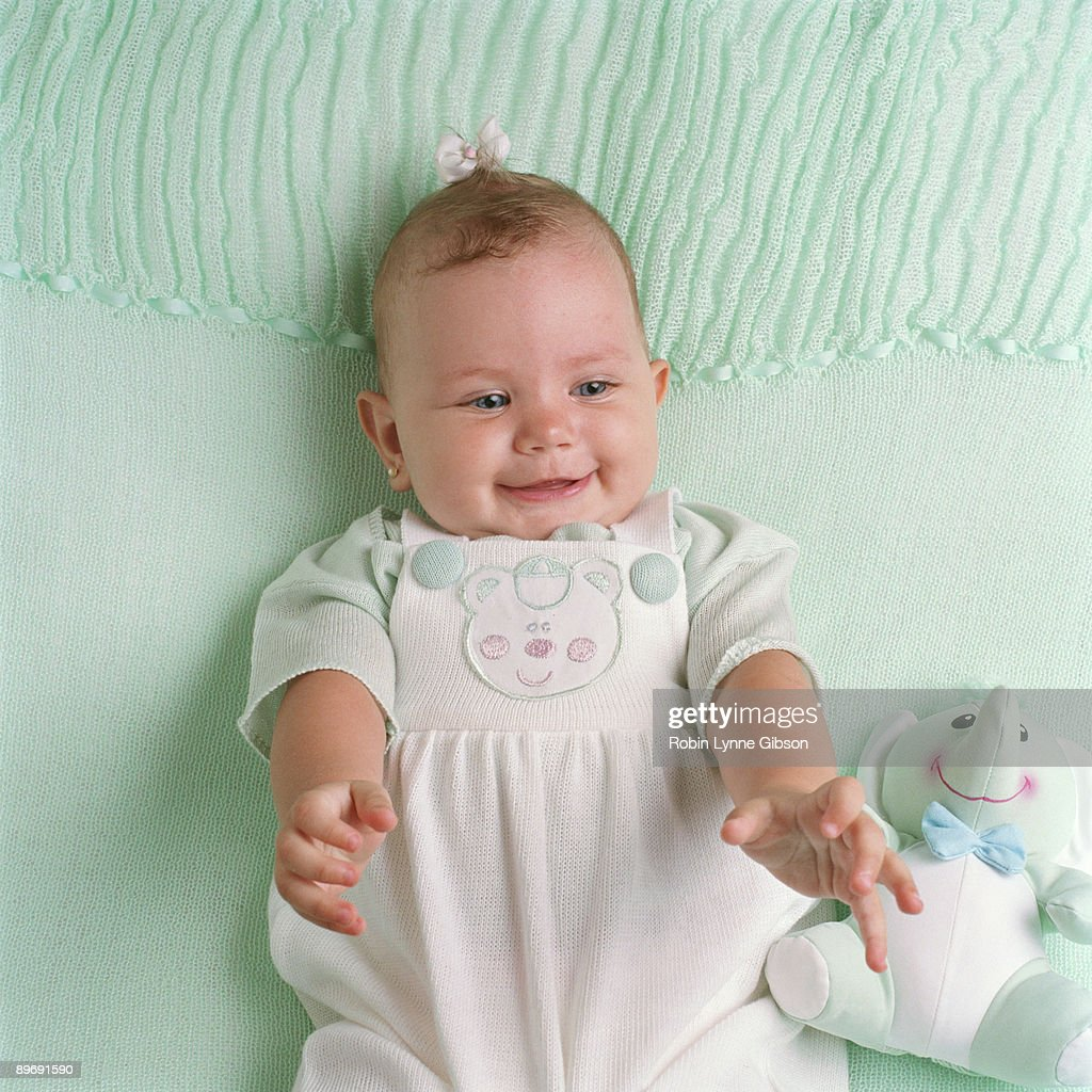 Baby reaching out : Stock Photo