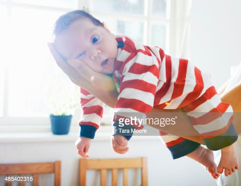 baby resting on mother's arm : Stock Photo