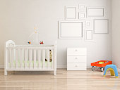 Baby's room, white furnitures, red and blank picture frame