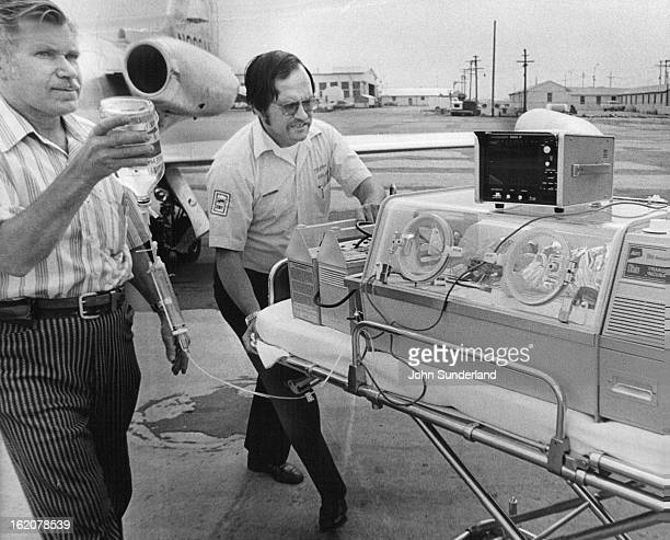 JUL 21 1973 Baby Rushed To Hospital In LifeSaving Effort One of two premature twins born Friday in Gunnison Colo is wheeled in an incubator to a...