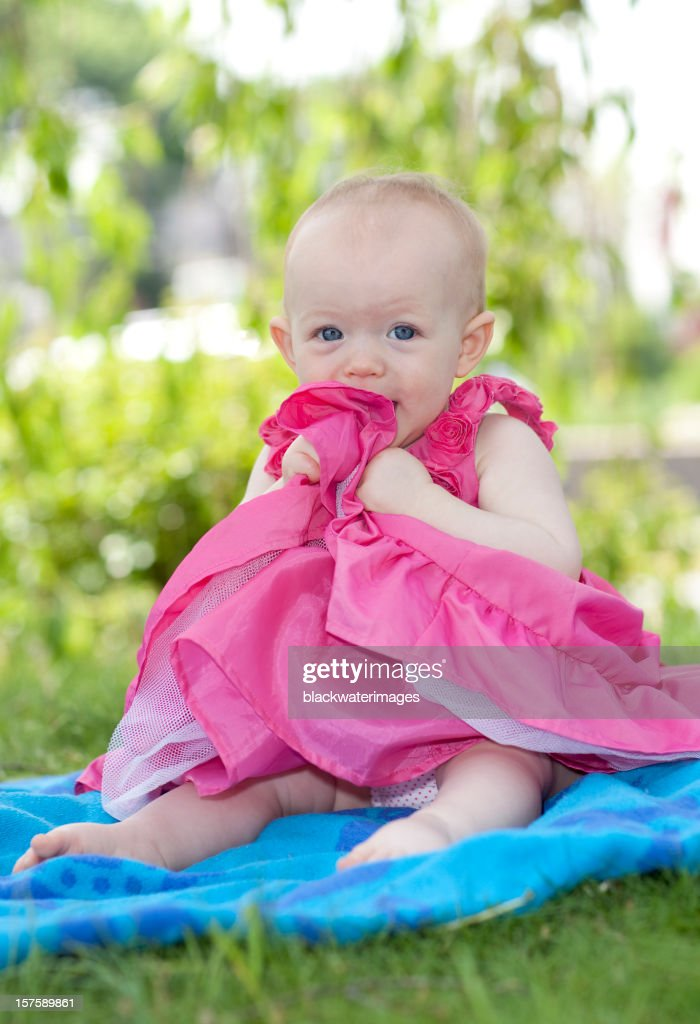 Baby sitting outdoors. : Stock Photo