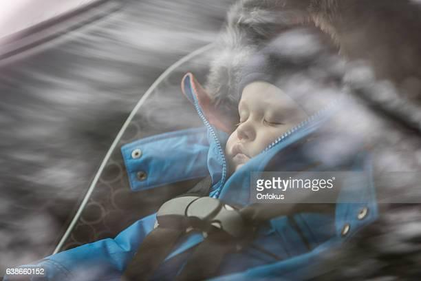 Baby Sleeping in Car Seat, Winter Season