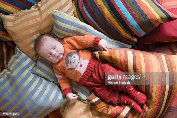Baby Sleeping on Striped Pillows