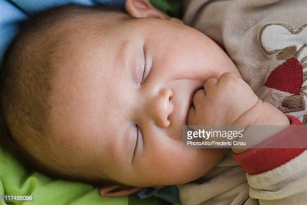 Baby sleeping with fingers in mouth