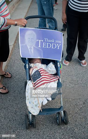 A baby sleeps as her mother waits in the 3 plus hour line to pay respects to Senator Edward M Kennedy at the John F Kennedy Library in Boston MA on...