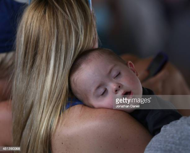 A baby sleeps as the Chicago Cubs take on the Washington Nationals at Wrigley Field on June 28 2014 in Chicago Illinois The Nationals defeated the...