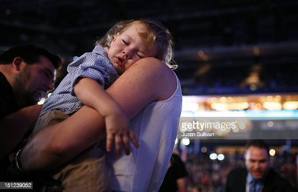 A baby sleeps during the start of day one of the Democratic National Convention at Time Warner Cable Arena on September 4 2012 in Charlotte North...