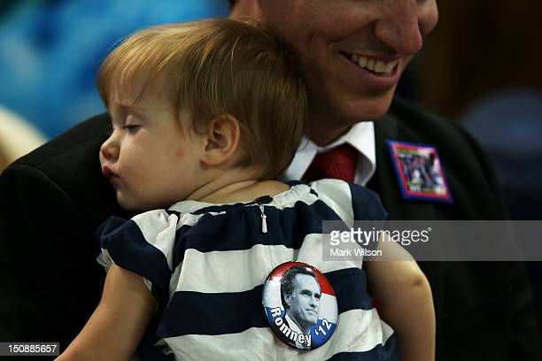 A baby sleeps while she wears a Republican presidential candidate former Massachusetts Gov Mitt Romney button during the Republican National...
