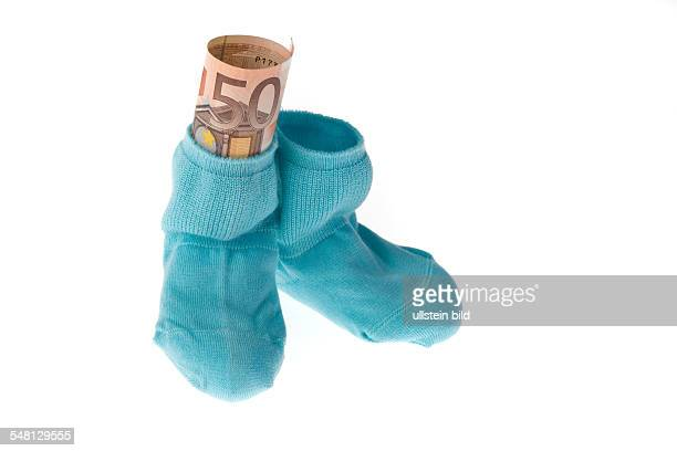 baby socks and Euro banknote