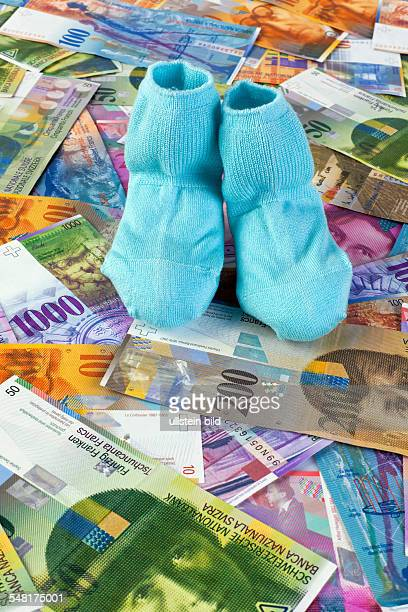 baby socks and Swiss Francs banknotes