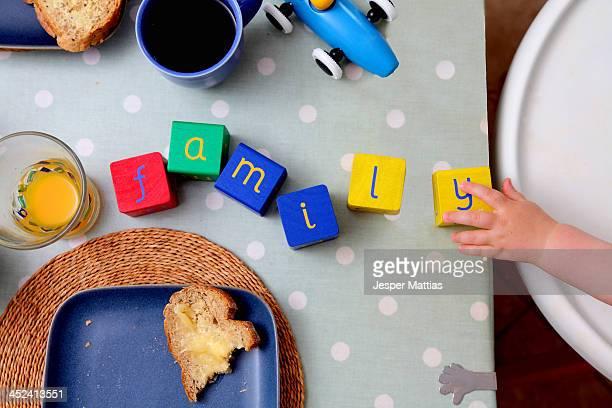 Baby spelling with alphabet blocks