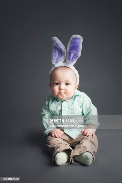 Baby Stares Seriously At the Camera Wearing Bunny Ears