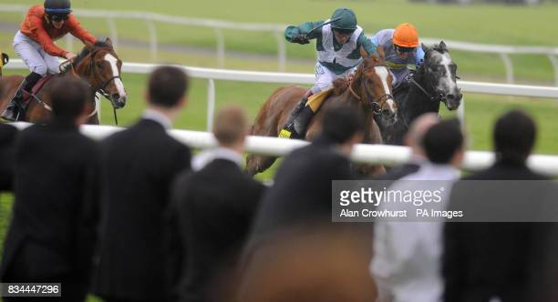 Baby Strange and Jim Crowley take it up close home to beat Holbeck Ghyll and Francis Norton to win The totetentofollowcouk Handicap during the...