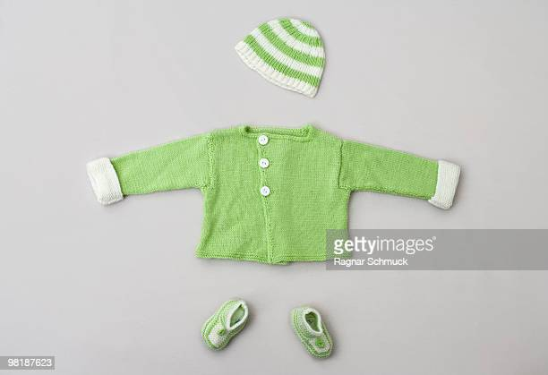 A baby sweater, knit hat and baby booties