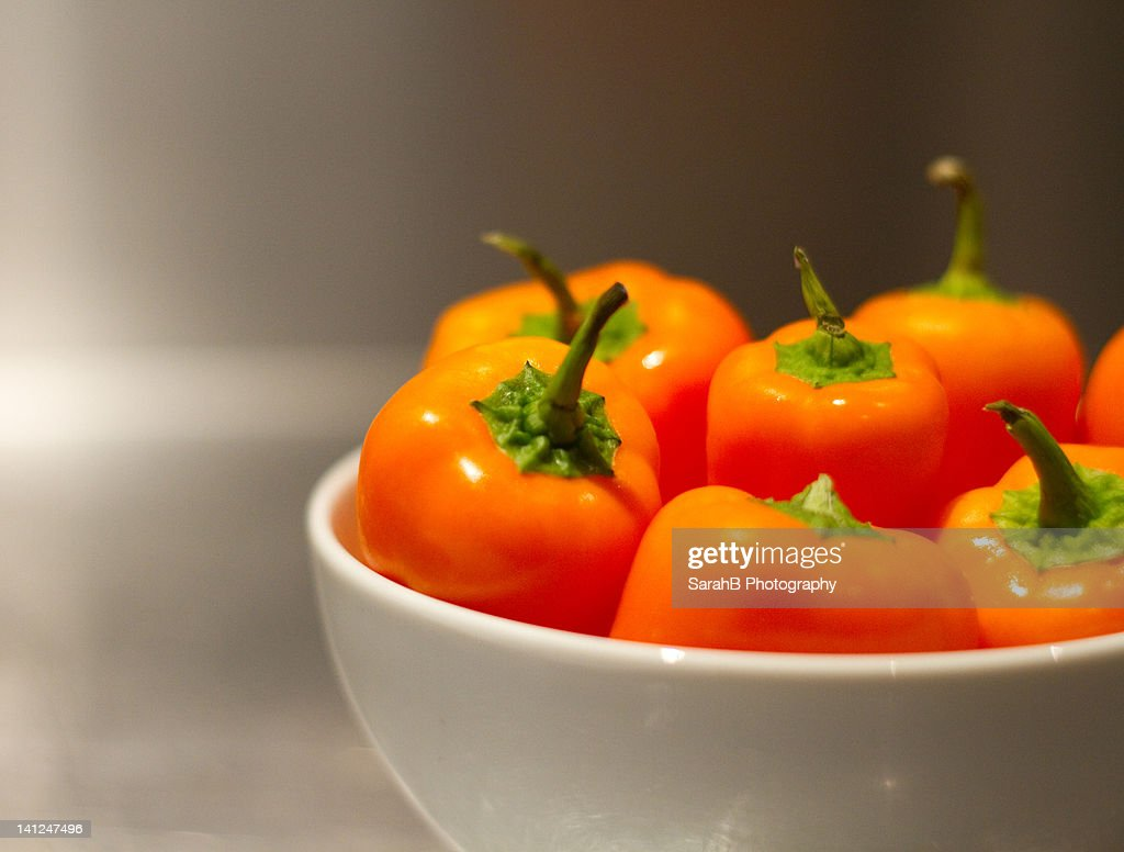 Baby sweet peppers in bowl : Stock Photo