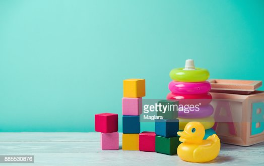 Baby toys on wooden table : Stock Photo