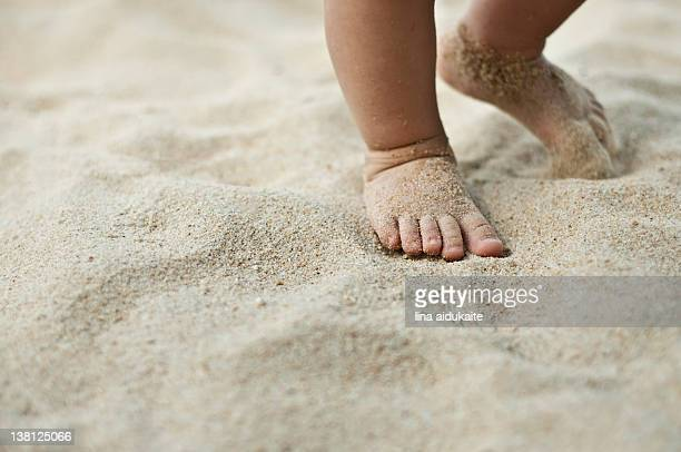 Baby walking on sand
