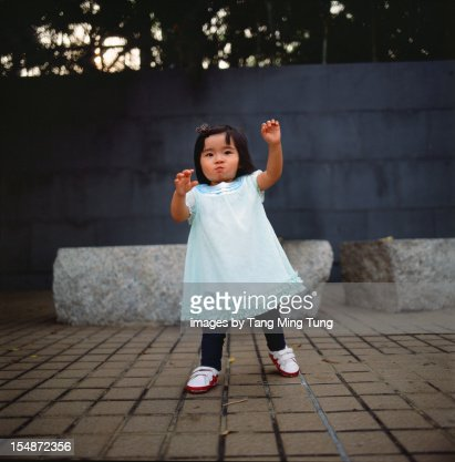 Baby Walks Towards Camera With Hands Reaching Out Stock ...