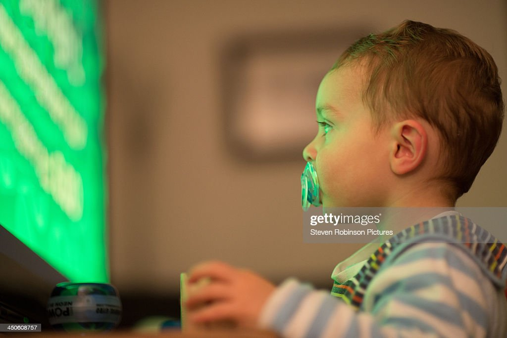 Baby watching television : Stock Photo